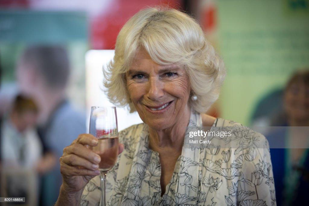 Camilla, Duchess of Cornwall tastes a locally produced wine at Newquay Fire Station as she meets residents from Tregunnel Hill, a mixed-use neighbourhood built on Duchy of Cornwall land in Newquay comprising open-market and affordable homes, during her annual trip to Devon and Cornwall on July 21, 2017 in Cornwall, England. The Prince of Wales also holds the title Duke of Cornwall.
