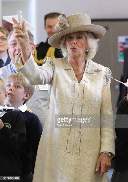 Camilla Duchess of Cornwall throws a paper plane with school children from Halton Community Combined School during a visit to RAF Halton on May 24...