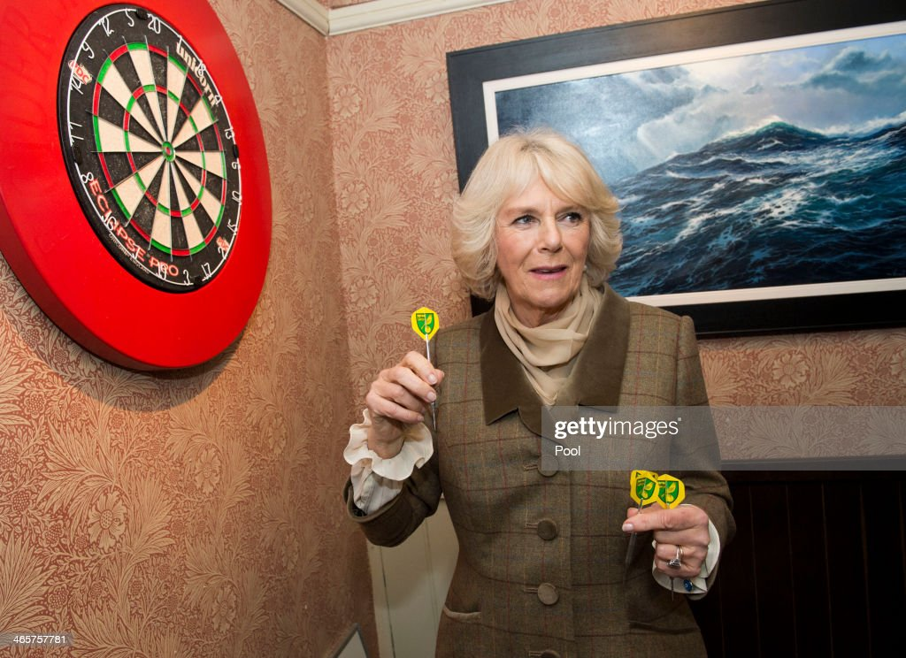 Camilla, Duchess of Cornwall throws darts during a visit to 'The Bell' Pub during an official visit to Essex on January 29, 2014 in Purleigh, United Kingdom.