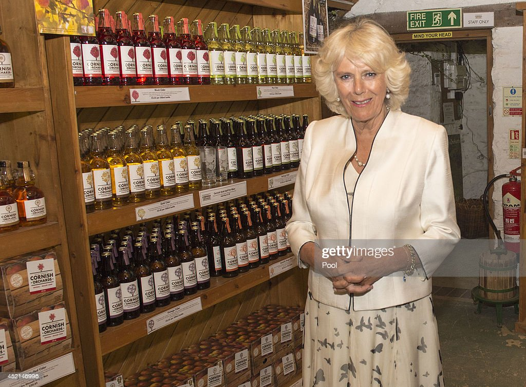Camilla, Duchess of Cornwall tours Cornish Orchards, a company which produces apple juice and cider, meeting staff and learning about the production process at Westnorth Manor Farm, Duloe on July 14, 2014 in Liskeard, England.