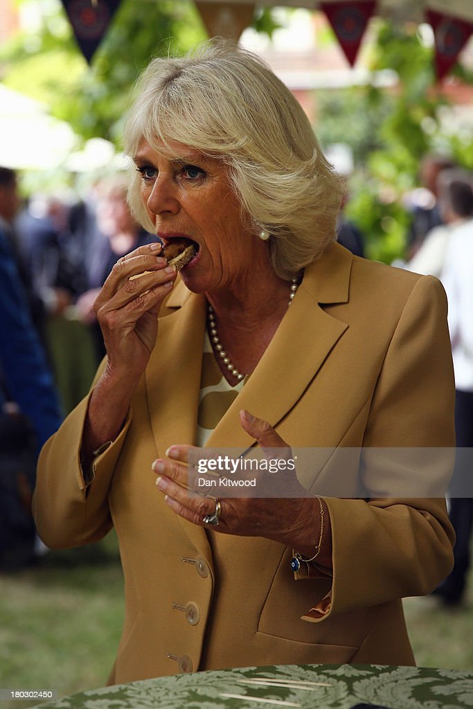 <a gi-track='captionPersonalityLinkClicked' href=/galleries/search?phrase=Camilla+-+Duchess+of+Cornwall&family=editorial&specificpeople=158157 ng-click='$event.stopPropagation()'>Camilla</a>, Duchess of Cornwall tries produce during a reception to celebrate the 21st anniversary of Duchy originals products at Clarence House on September 11, 2013 in London, England. The reception was held in the gardens of Clarence House, and attended by Duchy suppliers, Waitrose and other international stockists, customers, charitable beneficiaries and representatives of some of the charities who benefit from the sale of the products.