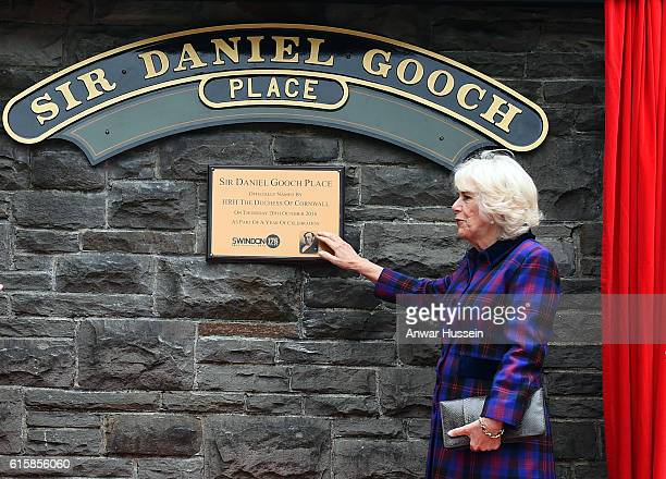 Camilla Duchess of Cornwall unveils a plaque as she opens Sir Daniel Gooch Place at Swindon Railway Station on October 20 2016 in Swindon England