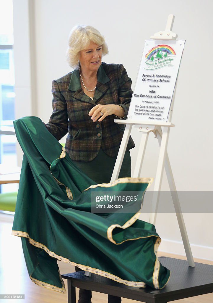 Camilla, Duchess of Cornwall unveils a plaque as she visits Forest and Sandridge Church of England Primary School during an away day to Wiltshire on February 9, 2016 in Melksham, England. The Duchess officially opened the new school building during her visit.