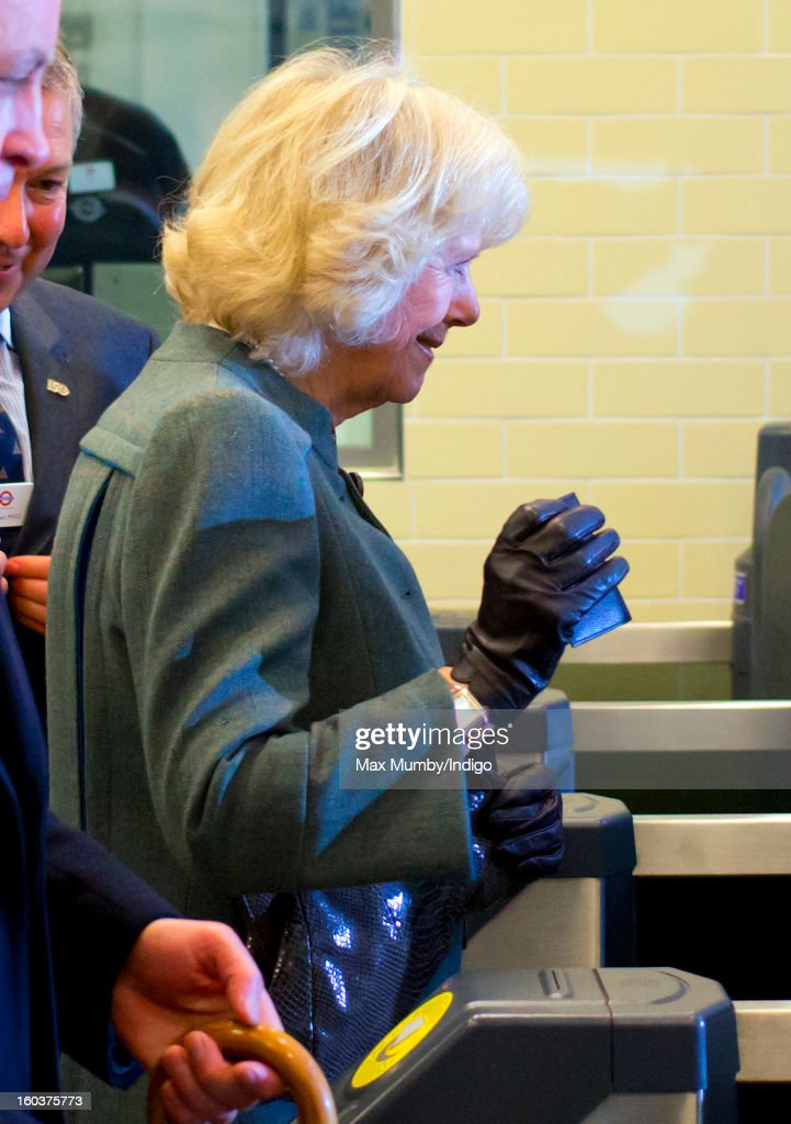 Camilla, Duchess of Cornwall uses her Oyster Card to pass through the ticket gate at Farringdon Underground Station as she prepares to travel on a Metropolitan underground train to King's Cross on January 30, 2013 in London, England. The Prince of Wales and The Duchess of Cornwall are marking the 150th anniversary of London Underground to emphasise the importance of engineering and infrastructure development in the UK.