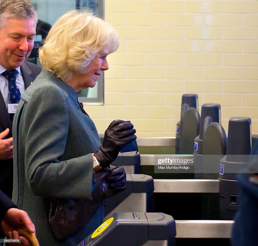Camilla, Duchess of Cornwall uses her Oyster Card to pass through the ticket gate at Farringdon Underground Station as she prepares to travel on a Metropolitan line underground train to King's Cross on January 30, 2013 in London, England. The Prince of Wales and The Duchess of Cornwall are marking the 150th anniversary of London Underground to emphasise the importance of engineering and infrastructure development in the UK.