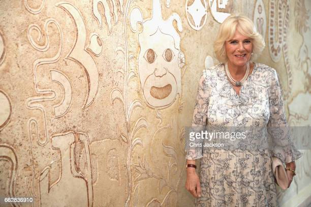 Camilla Duchess of Cornwall visits a mural of mafia symbols at La Gloriette a community centre based on a property which once belonged to one of the...
