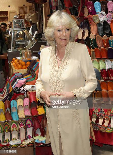 Camilla Duchess of Cornwall visits a traditional shoe shop in the Medina on day three of a three day visit to Morocco on April 6 2011 in Fez Morocco...