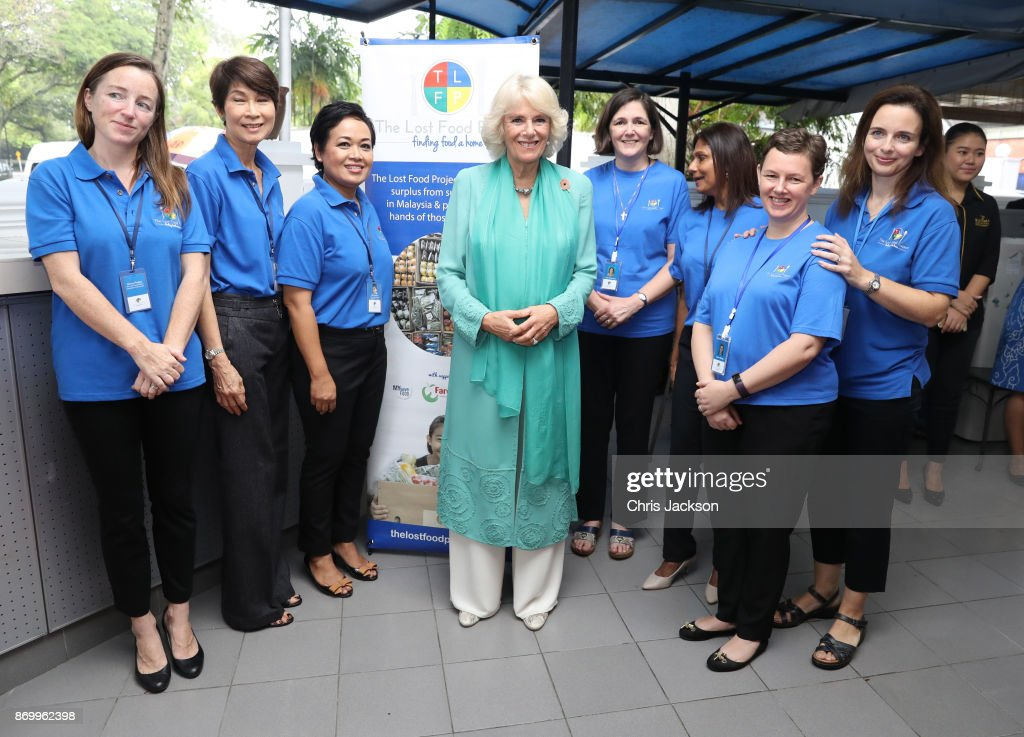 Camilla, Duchess of Cornwall (C) visits The Lost Food Project during her visit on November 4, 2017 in Kuala Lumpur, Malaysia. The Lost Food Project collects surplus food from supermarkets and manufacturers in Malaysia and distributes it to those who really need it. Prince Charles, Prince of Wales and Camilla, Duchess of Cornwall are on a tour of Singapore, Malaysia, Brunei and India.