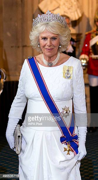 Camilla Duchess of Cornwall waits for her carriage as she leaves the Palace of Westminster following the Queen's Speech during the State Opening of...