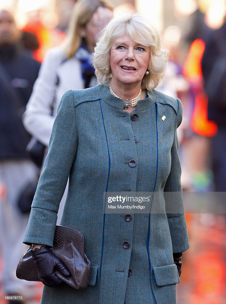 Camilla, Duchess of Cornwall walks to Farringdon Underground Station, after viewing the nearby Crossrail development site, to travel on a Metropolitan underground train to King's Cross on January 30, 2013 in London, England. The Prince of Wales and The Duchess of Cornwall are marking the 150th anniversary of London Underground to emphasise the importance of engineering and infrastructure development in the UK.