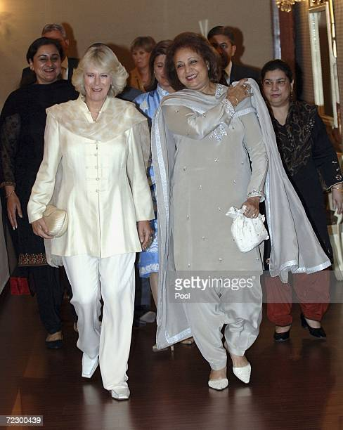Camilla Duchess of Cornwall walks with the President of Pakistan's wife Sehba Musharraf prior to a meeting at the Presidential Palace on October 30...