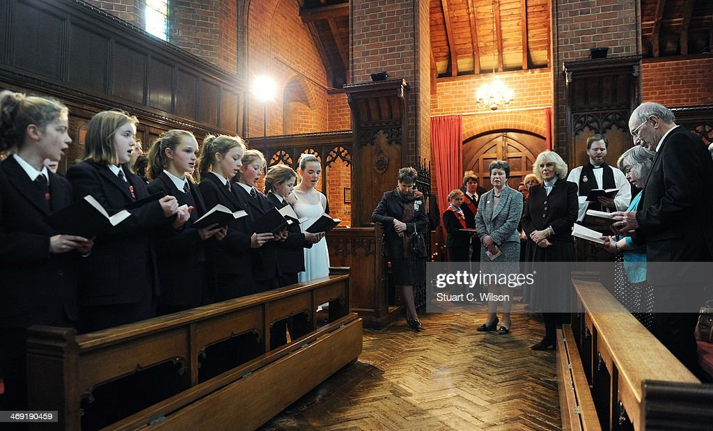 Camilla, Duchess Of Cornwall watches a chorus of girls as he visits St Catherine's School in Bramley, Surrey on February 13, 2014 in Guildford, England.