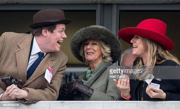 Camilla Duchess of Cornwall watches a race from the temporary Royal Box with her son Tom Parker Bowles and daughter Laura Lopes on the second day of...