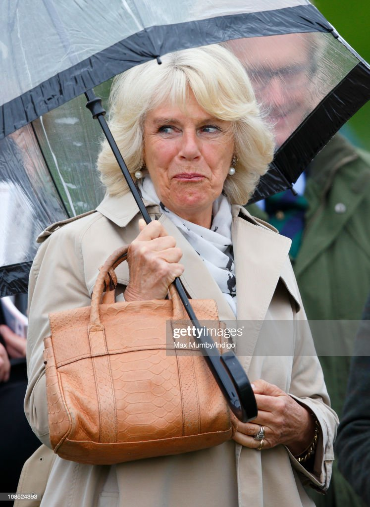 Camilla, Duchess of Cornwall watches one of Queen Elizabeth's horses compete in the Highland class on day 3 of the Royal Windsor Horse Show on May 10, 2013 in Windsor, England.