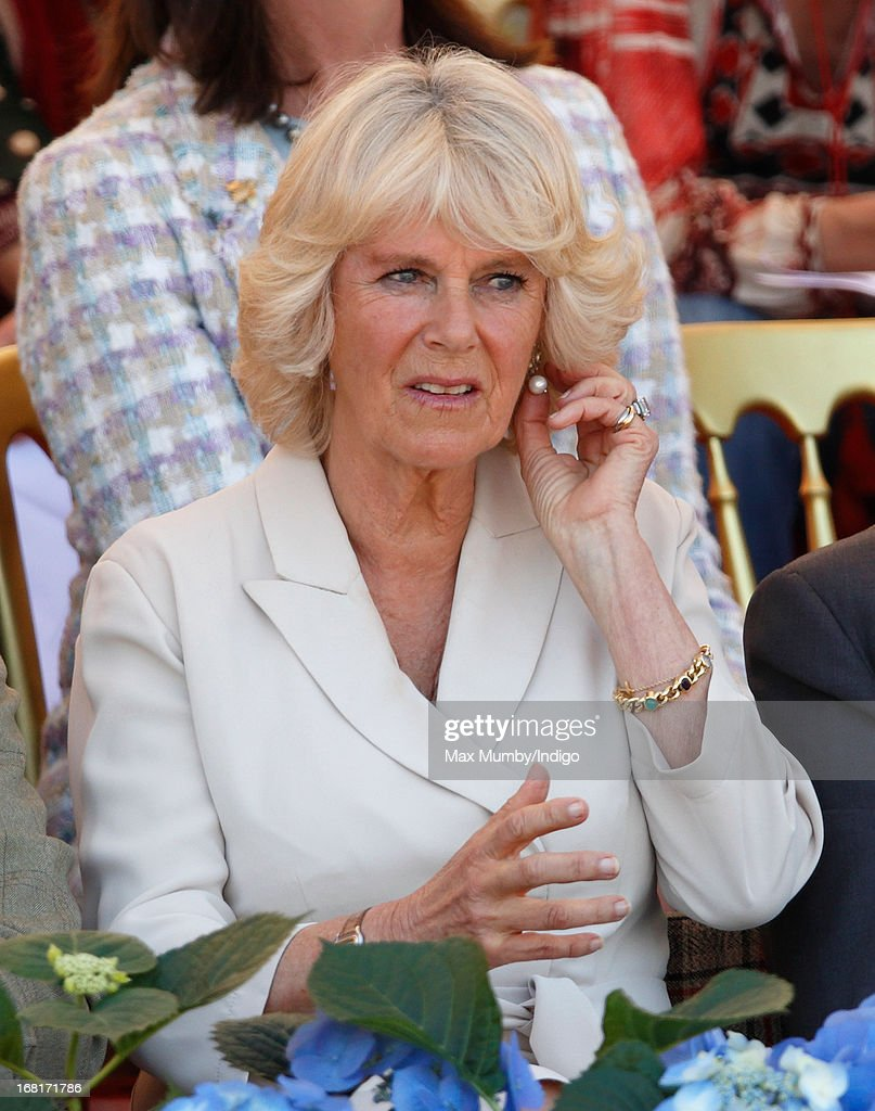 Camilla, Duchess of Cornwall watches the show jumping phase of the Badminton Horse Trials on May 6, 2013 in Badminton, England.