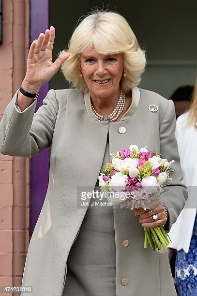 Camilla Duchess of Cornwall waves as she visits Ballyhackamore Credit Union on May 21 2015 in Belfast Northern Ireland Prince Charles Prince of Wales...