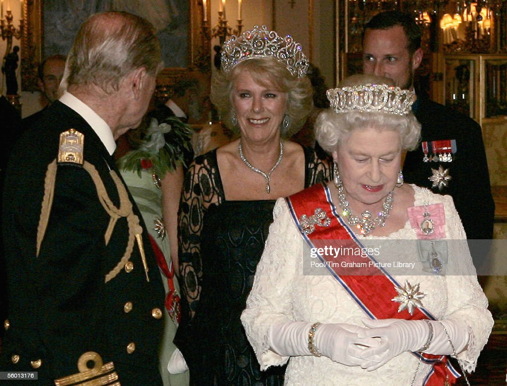 Camilla Duchess of Cornwall, wearing a Royal heirloom of diamond tiara, necklace and earrings, attends a banquet in Buckingham Palace with Prince Philip The Duke of Edinburgh, Queen Elizabeth II and Crown Prince Haakon of Norway on October 25, 2005 in London, England. This is the first time that Camilla has worn the royal tiara and only the third time the priceless jewelry has been worn in public.
