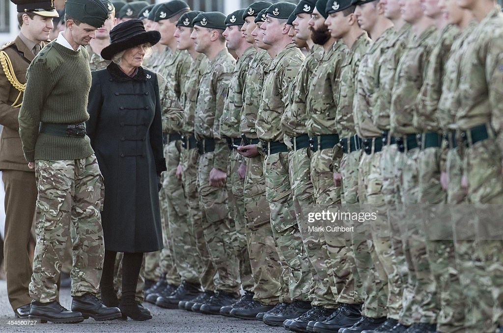 Camilla, Duchess of Cornwall welcomes home the 4th Battalion The Rifles and presents medals on their return from Afghanistan on December 9, 2013 in Wiltshire, England.