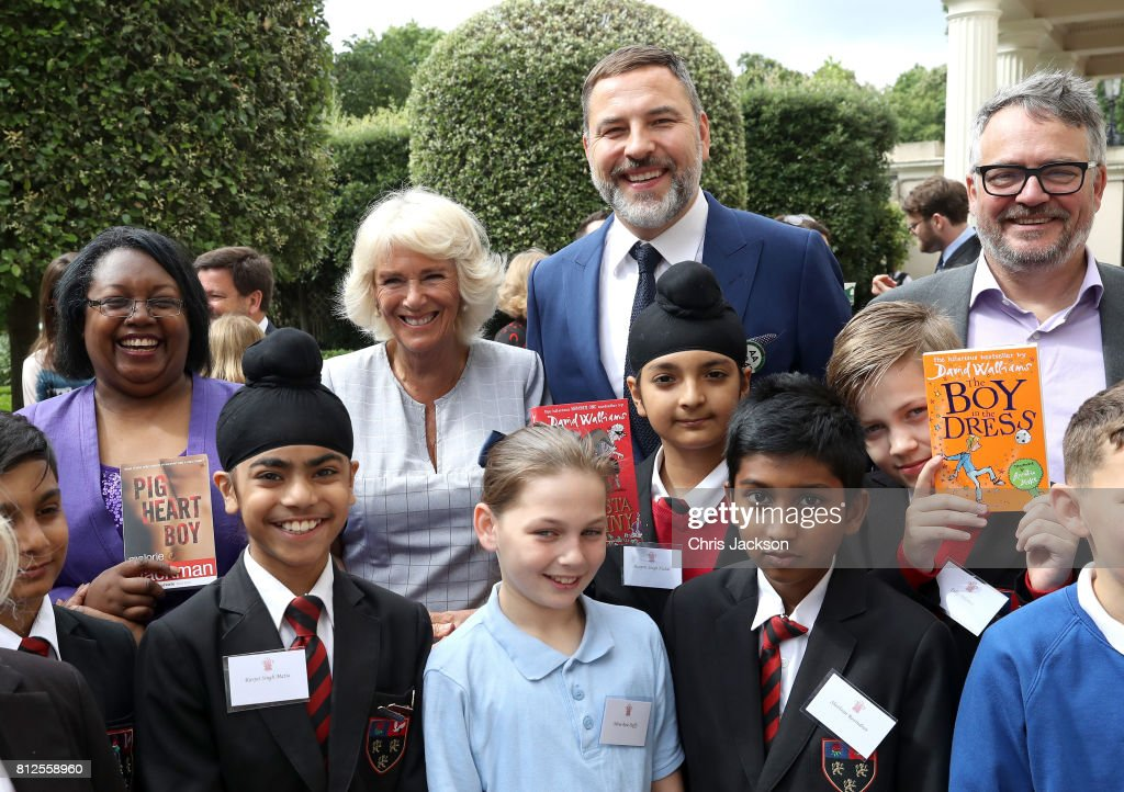 Camilla, Duchess of Cornwall (second left) with comedian and author David Walliams (second right) dressed as an bus conductor, and school children from Hemlington Hall Academy in Middlesbrough and Berkeley Primary School in Hounslow ahead of a tea party hosted by the Duchess of Cornwall to celebrate the Duchess's Bookshelves Project at Clarence House on July 11, 2017 in London, England. The Project is an initiative to find the nation's 70 favourite children's books to mark the Duchess of Cornwall's 70th birthday.