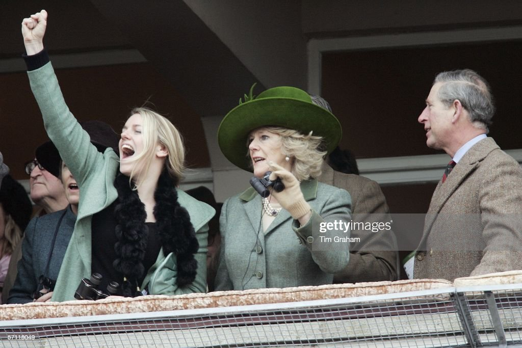 Camilla, Duchess of Cornwall with her daughter Laura Parker-Bowles and <a gi-track='captionPersonalityLinkClicked' href=/galleries/search?phrase=Prince+Charles+-+Prince+of+Wales&family=editorial&specificpeople=160180 ng-click='$event.stopPropagation()'>Prince Charles</a>, Prince of Wales watch the Gold Cup race on the final day of Cheltenham Races on March 17, 2006 in Cheltenham, England.