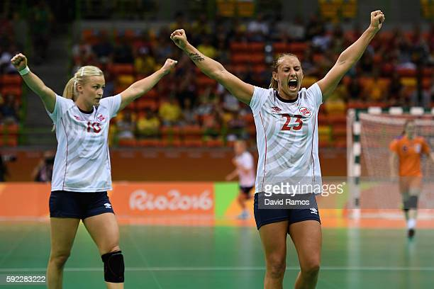 Camilla Herrem and Stine Bredal Oftedal of Norway celebrate during the Women's Handball Bronze medal match between Netherlands and Norway at Future...