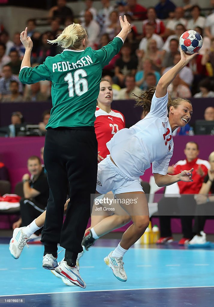 Camilla Herrem #23 of Norway shoots the ball past goalkeeper Christina Pedersen #16 of Denmark during the Women's Handball Preliminaries Group A match between Norway and Denmark on Day 7 of the London 2012 Olympic Games at Copper Box on August 3, 2012 in London, England.