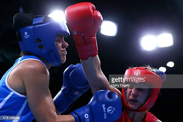 Camilla Jensen of Denmark and Valentina Alberti of Italy compete in the Women's Boxing Light Welterweight Quarter Final during day eleven of the Baku...