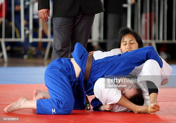 Camilla Marcellet of Argentina fights with Katerine Manrique of Bolivia during Women's Judo as part of the I ODESUR South American Youth Games at...