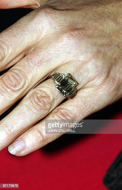 Camilla Parker Bowles shows off her engagement ring as she and Prince Charles arrive for a party at Windsor Castle after announcing their engagement...