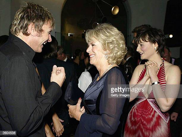 Camilla Parker Bowles speaks with Simon Le Bon from the band Duran Duran at the after party for the 'Fashion Rocks' concert and fashion show to...