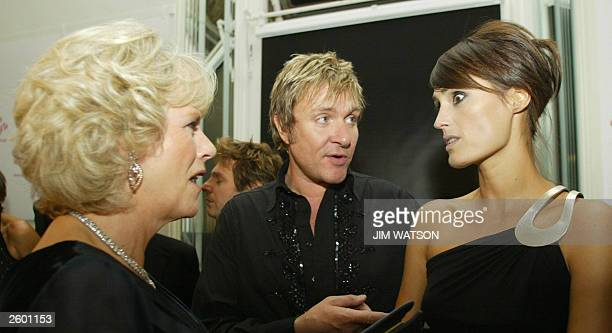 Camilla Parker Bowles speaks with singer Simon Le Bon and his wife Yasmin during the reception at the 'Fashion Rocks' concert and fashion show 15...