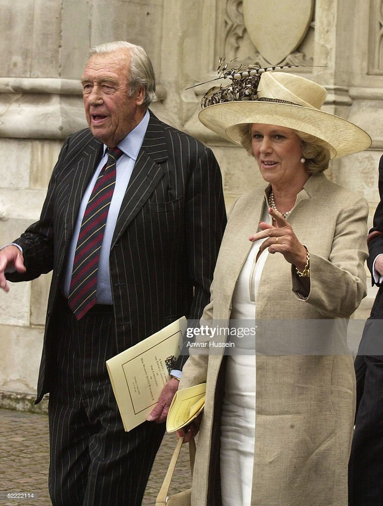 Camilla Parker Bowles, wearing a Philip Treacy hat, and her father Bruce Shand leave Westminster Abbey on June 2, 2003 after the ceremony to mark the 50th anniversary of the coronation in London, England.
