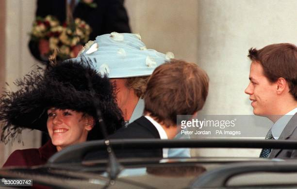 Camilla Parker Bowles wearing a threequarter length pastel blue suit and matching hat with her daughter Laura and son Tom today before she met Prince...