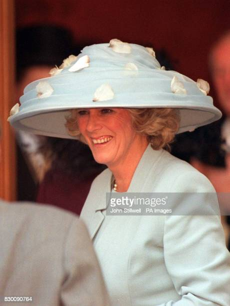 Camilla Parker Bowles wearing a threequarter length pastel blue suit and matching hat today before she met Prince Charles for the biggest society...