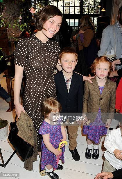 Camilla Rutherford and children attend the launch of the Natalia Dress inspired by Natalia Vodianova to benefit her Naked Heart Foundation at Caramel...