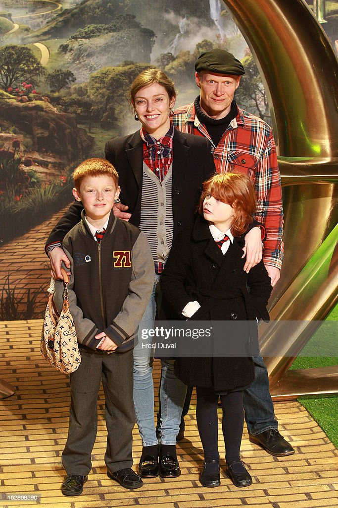Camilla Rutherford, her son Hector Abbott (L), her daughter Maud Abbott and Dominic Burns attend the European Film Premiere of 'Oz: The Great And Powerful' at The Empire Cinema on February 28, 2013 in London, England.