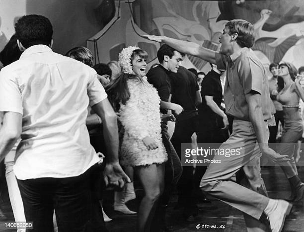 Camilla Sparv dances with unknown actor in a scene from the film 'Murderers' Row' 1966