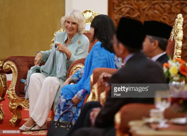 Camilla The Duchess of Cornwall awaits the arrival of His Majesty The Yang diPertuan Agong XV Sultan Muhammad V at his official residence Istana...