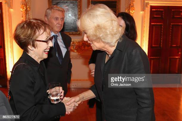 Camilla The Duchess of Cornwall greets Una Stubbs at The Royal Academy of Arts To launch the RA250 Friends Membership scheme on October 16 2017 in...