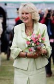 Camilla the Duchess of Cornwall holds flowers during her visit to the Sandringham Flower Show on July 27 2005 in Sandringham Norfolk
