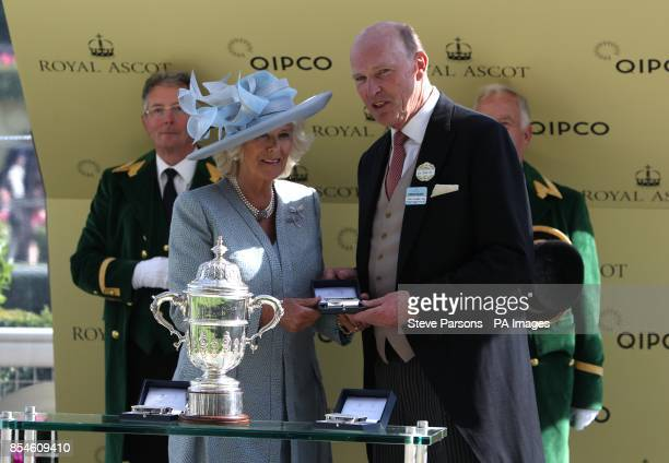 Camilla The Duchess of Cornwall presents the winner of St James's Palace Stakes to trainer John Gosden during Day One of the 2014 Royal Ascot Meeting...