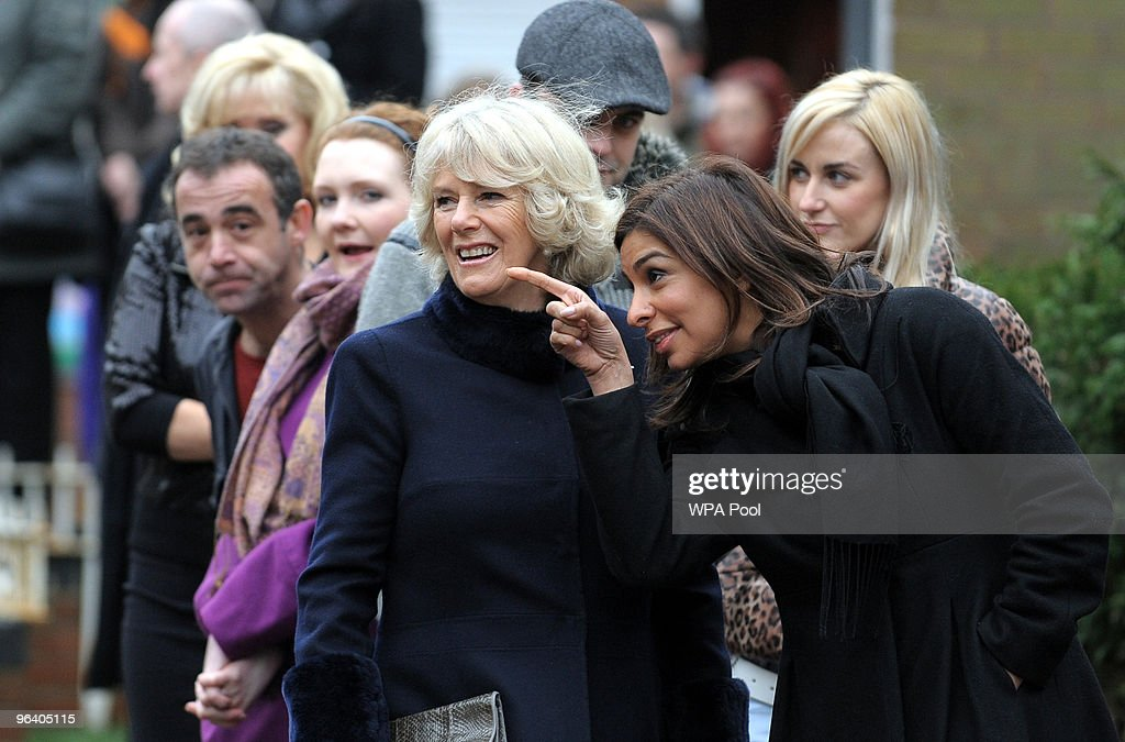 Camilla, The Duchess of Cornwall (C) speaks with actress Shobna Gulati, who plays the role of Sunita Alahan (R) during a tour of the Coronation Street set on February 4, 2010 in Manchester, England.