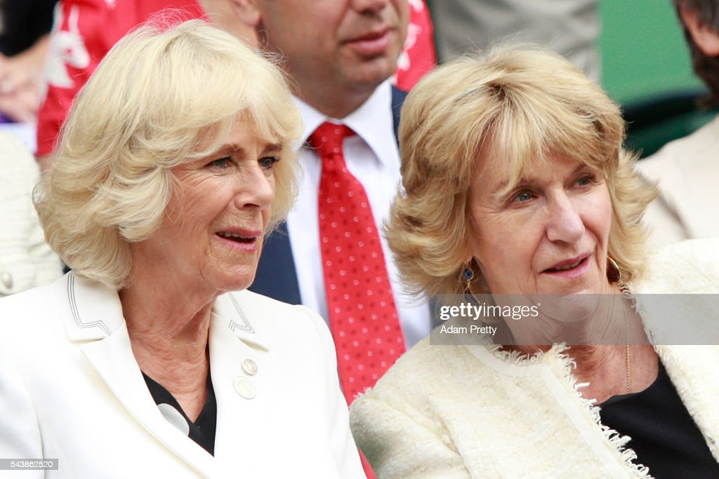 Camilla, the Duchess of Cornwall watches on from the stands in centre court as Julien Benneteau of France is in action during the Men's Singles second round match against Kei Nishikori of Japan on day four of the Wimbledon Lawn Tennis Championships at the All England Lawn Tennis and Croquet Club on June 30, 2016 in London, England.