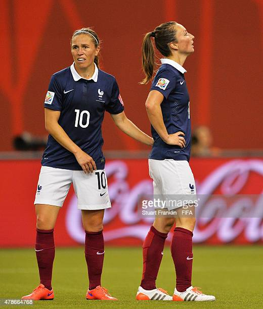 Camille Abily and Gaetane Thiney of France look dejected during the quarter final match of the FIFA Women's World Cup between Germany and France at...