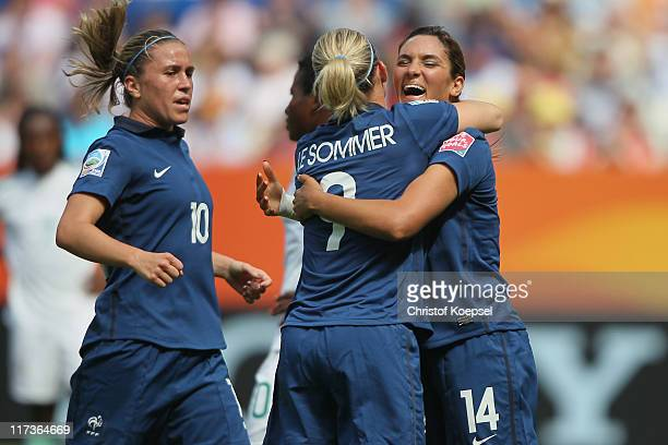 Camille Abily Eugenie Le Sommer and Louisa Necib of France celebrate the first goal of MarieLaure Delie of France during the FIFA Women's World Cup...