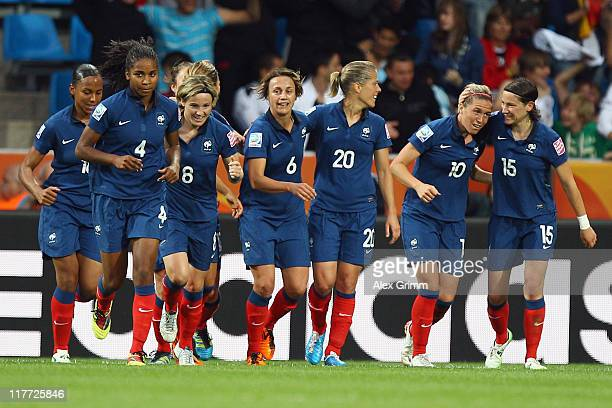 Camille Abily of France celebrates her team's third goal with team mates during the FIFA Women's World Cup 2011 Group A match between Canada and...