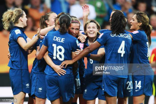 Camille Abily of France celebrates with her team mates after scoring her team's third goal during the FIFA Women's World Cup 2011 Group A match...