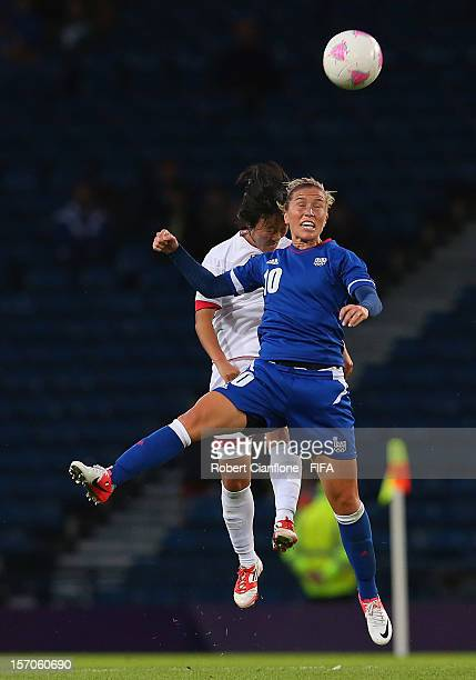 Camille Abily of France heads the ball during the Women's Football first round Group G Match of the London 2012 Olympic Games between France and...