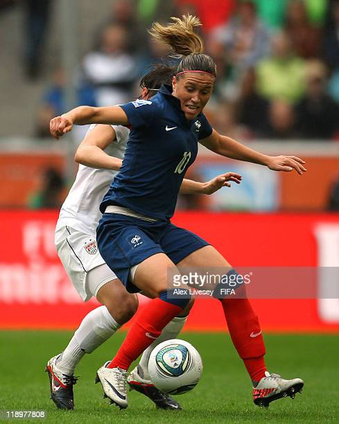 Camille Abily of France holds off a challenge from Amy Le Peilbet of USA during the FIFA Women's World Cup Semi Final match between France and USA at...
