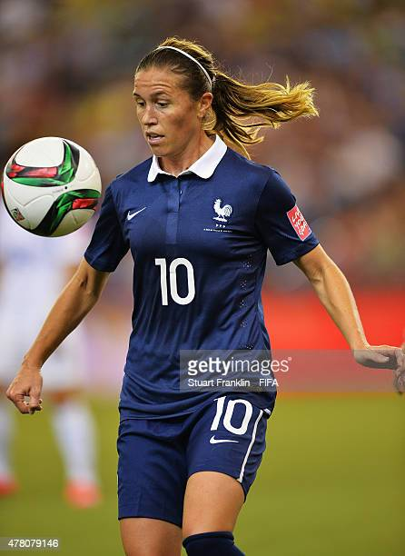 Camille Abily of France is challenged by of Korea during the FIFA Womens's World Cup round of 16 match between France and Korea at Olympic Stadium on...